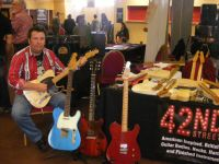 Nick Davis, Johnny Cash roadshow guitarist tries a model T5E  at the Bristol guitar show © 2018 42nd Street Guitars